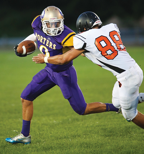 Zach Holmes of Greenport/Southold/Mattituck tries to thwart an attempted tackle by Babylon's James Messina. (Credit: Garret Meade)