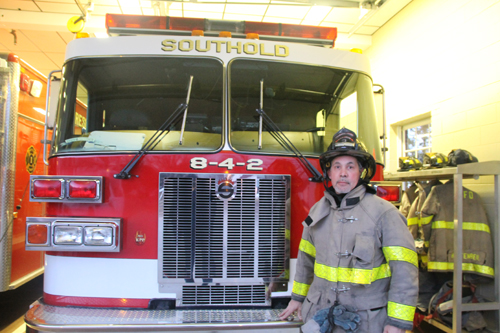 (Photo by Paul Squire) Captain Barry Standish at Southold Fire Department headquarters.