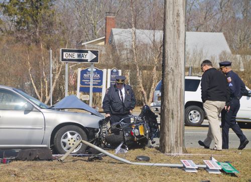 Southold Town police investigate the scene of Thursday morning's crash. (Credit: Paul Squire)