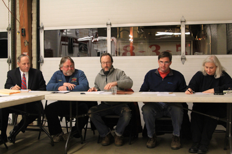 Joseph Prokop (pictured on the far left) will continue to provide legal advice to the village. (file photo)