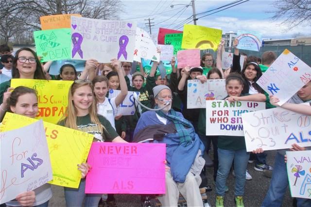 Junior high students display their signs. (Credit: Barbaraellen Koch photos)