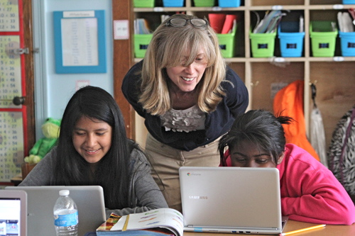 Greenport fifth-grade teacher assistant Jeannie Calderale with students Kelly Torres-Rodriguez, left, and Breanna Shelby. (Credit: Jennifer Gustavson)
