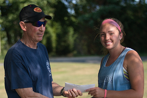 Tournament director Jim Christy presenting a scholarship to Molly Kowalski before the women's singles final of the Bob Wall Memorial Tennis Tournament. (Credit: Garret Meade)