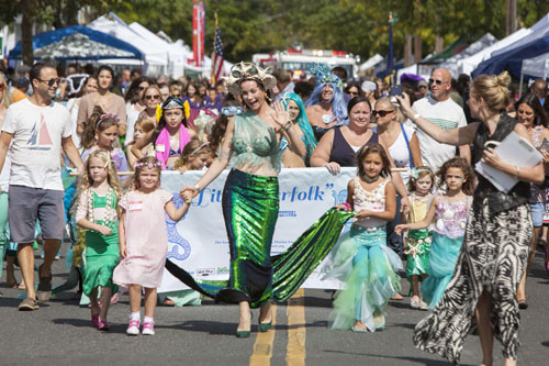 Contestants in the Little Merfolk Contest participate in the parade at the Greenport Maritime Festival last September. (Credit: Katharine Schroeder, file)