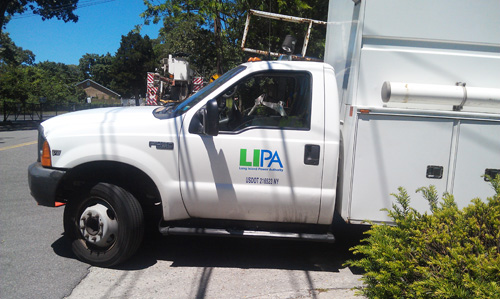 JENNIFER GUSTAVSON PHOTO | Long Island Power Authority trucks on Factory Avenue in Mattituck Wednesday afternoon.