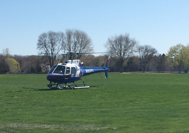 A Suffolk County Police helicopter landed at Southold High School Saturday to transport the victim of an accident. (Credit: Cyndi Murray)