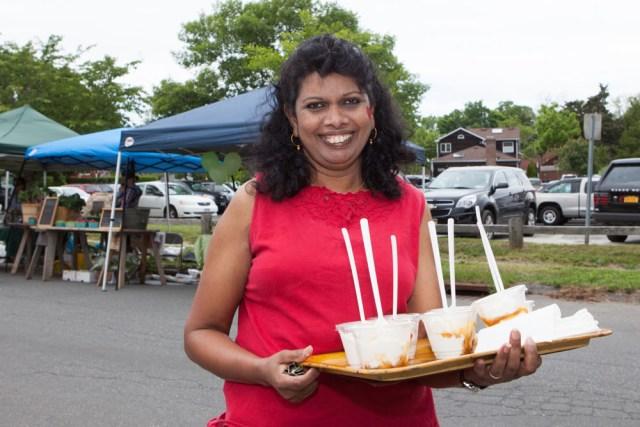 Volunteer Daisy Clasing of Mattituck sells ice cream to raise money.