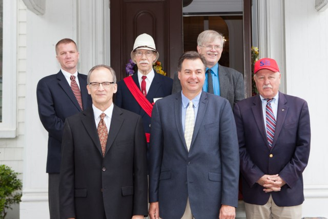 Dignitaries pose on the church steps.