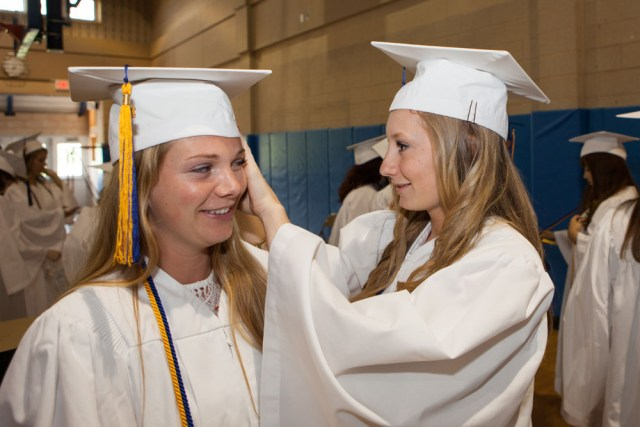 Kaylee Bergen gives Olivia Finn a hand before the ceremony. (Credit: Katharine Schroeder)