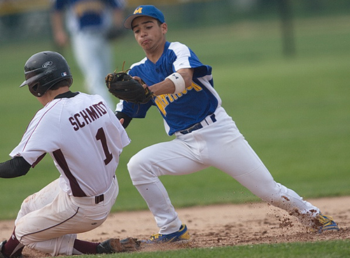 GARRET MEADE PHOTO   Southampton's Wyatt Schmidt is tagged out by Mattituck shortstop Marcos Perivolaris while trying to steal second base in the first inning.