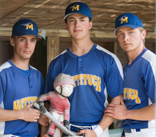 From left, Joe Tardif, Jon Dwyer and Will Gildersleeve with Optimus, a hockey gnome that has served as Mattituck's good-luck charm this season. (Credit: Katharine Schroeder)
