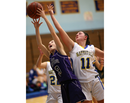 Port Jefferson's Jillian Colucci and Mattituck's Courtney Penny reach for a rebound. (Credit: Garret Meade)