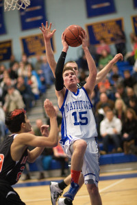 GARRET MEADE PHOTO | Mattituck's Ian Nish, with Babylon's Jacob Carlock behind him and Fernando Vazquez to his right, attacking the basket.