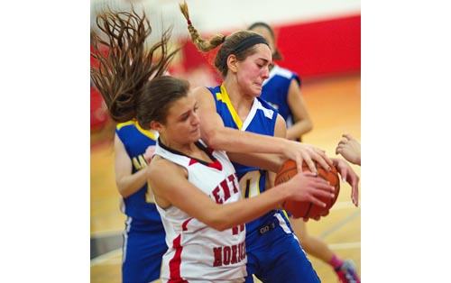 Mattituck's Katie Hoeg, wrestling for the ball with a Center Moriches player last season, is an all-league forward heading into her fourth varsity season. (Credit: Garret Meade file)
