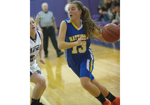 GARRET MEADE PHOTO | Mattituck's Liz Dwyer dribbling into the paint during Monday night's game in Hampton Bays. The Tuckers were outrebounded by 42-21 and whistled for 21 fouls.