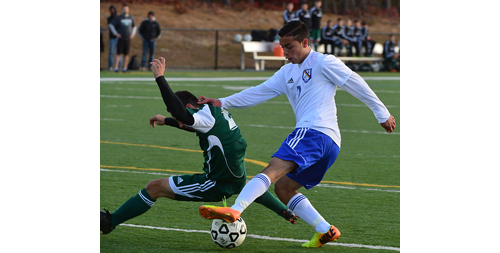 ROBERT O'ROURK PHOTO | Mattituck's Mario Arreola fighting for control of the ball during the regional semifinal against Carle Place on Tuesday at Diamond in the Pines.