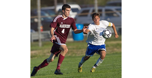 GARRET MEADE PHOTO   Southampton's Elliot LaGuardia and Mattituck's Paul Hayes in pursuit of the ball.