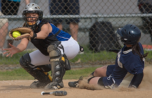 GARRET MEADE FILE PHOTO   Mattituck catcher Brittany Tumulty, shown receiving a throw in a game against Bayport-Blue Point in 2011, has rejoined the team after a one-year sabbatical.