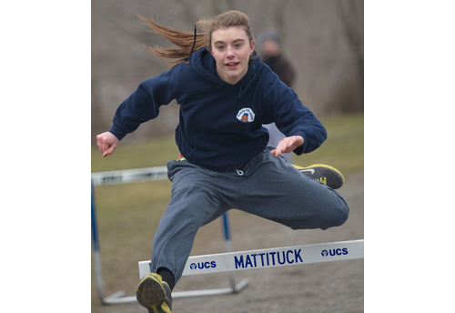 GARRET MEADE PHOTO | Shannon Dwyer, a pentathlon veteran, working on her hurdling during Mattituck's practice on Monday.