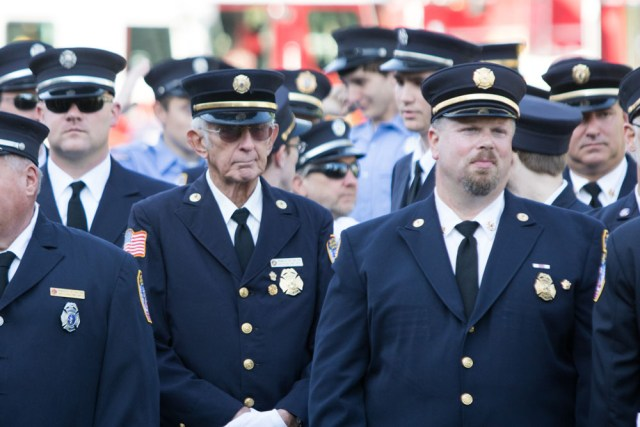 The Mattituck Fire Department held a ceremony at the war memorial at Pike Street and Wickham Avenue. (Credit: Katharine Schroeder)