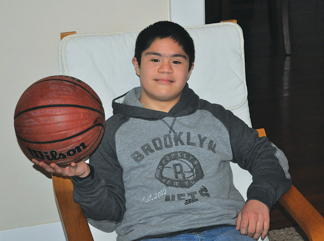 Following an unselfish act from an opposing team and with the support of his beloved teammates Miguel Borrayo, who has Down syndrome, scored the first points of his school basketball career Jan. 8.