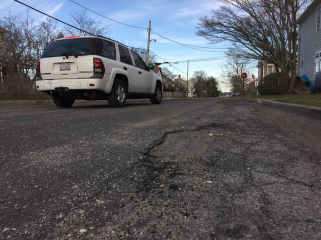 Potholes, a major campaign issue, are about to get fixed in Greenport. (Credit: Paul Squire)