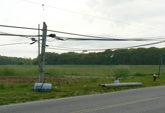 The scene Wednesday morning where a car crashed into a pole on New Suffolk Avenue. (Credit: Donald Kirby)