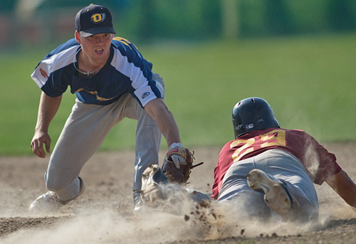 GARRET MEADE PHOTO | North Fork shortstop Eric Solberg tagging out Riverhead's Josh Mason in a game last summer.