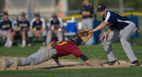 GARRET MEADE PHOTO | Riverhead's Michael Brosseau dove safely back to the bag before North Fork first baseman Mike Hayden could slap a tag on him.