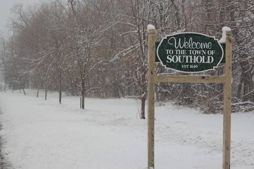 JENNIFER GUSTAVSON FILE PHOTO | A snowy Southold Town sign on Main Road in Mattituck.
