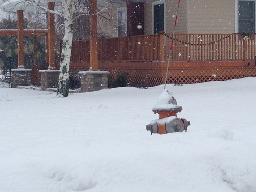 PAUL SQUIRE PHOTO | A fire hydrant in Calverton half-buried in the snow Tuesday morning.