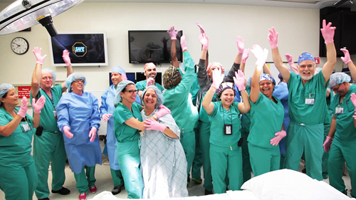 STONY BROOK MEDICINE COURTESY PHOTO | The operating room team at Stony Brook University Hospital dances and wears pink gloves during a video shoot for the national competition.