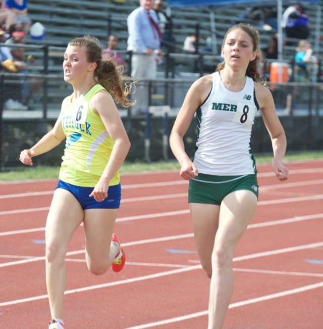 Melanie Pfennig (left) and Kaitlyn Butterfield cross in the 1,500.