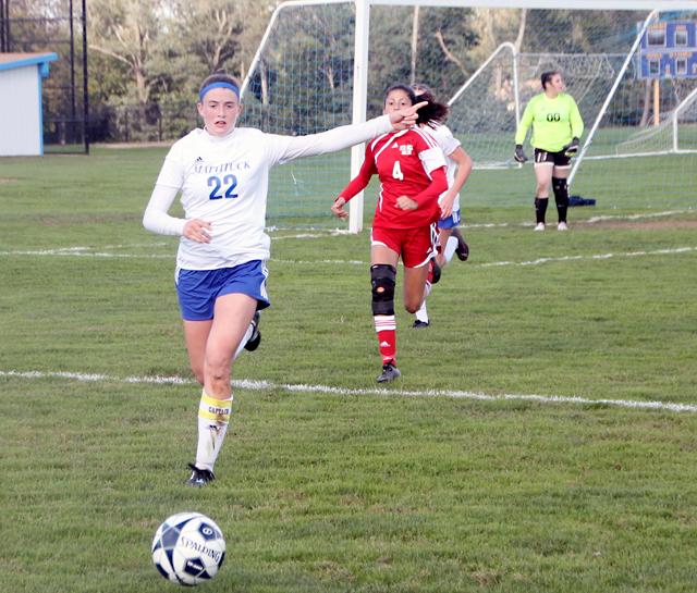 Mattituck's Corinne Reda looks to push the ball up field. (Credit: Joe Werkmeister)