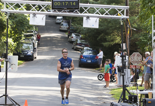 KATHARINE SCHROEDER PHOTO   Shawn Fitzgerald of Cutchogue was the first to reach the finish line in 17 minutes 15.01 seconds.