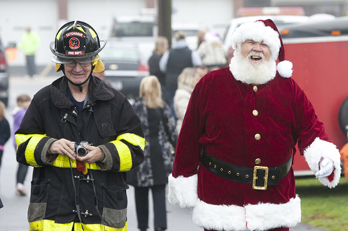 KATHARINE SCHROEDER PHOTO | Santa's greeting by firefighters in Cutchogue.