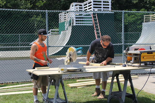 Volunteers help make upgrades to the Greenport Skate Park on Moores Lane Tuesday afternoon. (Cyndi Murray photo)