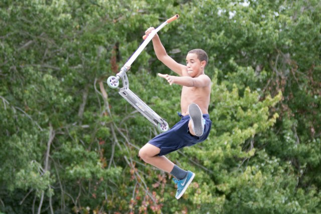 Isaiah Johnson, 12, of Southold does a stunt in mid-air.