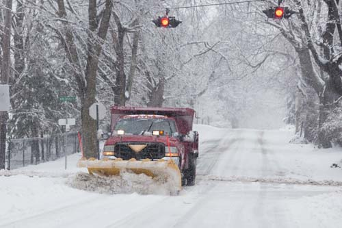 A Southold snow plow out in a February storm. (Credit: Katharine Schroeder, file)