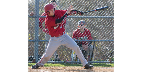 Southold's Alex Poliwoda makes a connection on a pitch during Thursday's game against Pierson/Bridgehampton. (Credit: Katharine Schroeder)