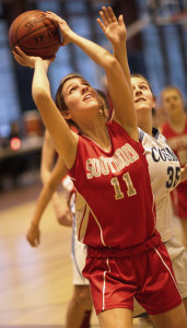GARRET MEADE PHOTO | Southold's Nicole Busso, looking for shooting room with Kendall Scala of The Ross School trying to block her shot, put in 12 points.