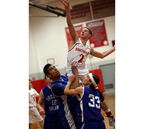 Southold's Shayne Johnson leans over Shelter Island's Semaj Lawrence and Peter Kropf (33). (Credit: Garret Meade)