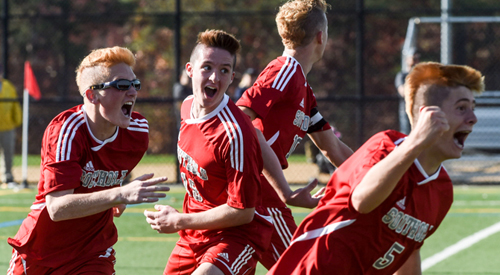 Sean Moran (5) pumps his fist after scoring in sudden-victory overtime to bring Southold a second straight county title. Joining in the celebration are, from left, Ryan DiGregorio, Walker Sutton and Shayne Johnson. (Credit: Robert O'Rourk)