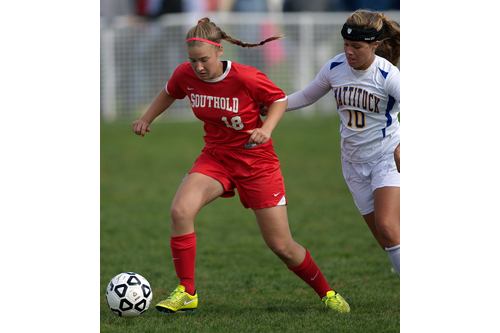Southold/Greenport's Jillian Golden is challenged for the ball by Mattituck's Catherine Hayes. (Credit: Garret Meade)