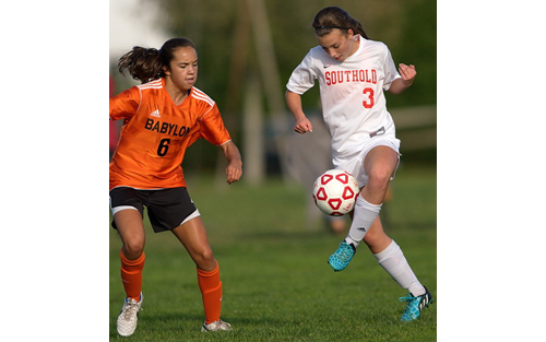 Babylon's Olivia Maldonado, who scored twice, and Southold/Greenport's Sabrina Basel in action during Thursday's game at Southold High School. (Credit: Garret Meade)