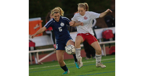 GARRET MEADE PHOTO   Stony Brook's Emma Lavery, left, and Southold/Greenport's Sophie Pickerell compete for the ball during the Suffolk County Class C final.
