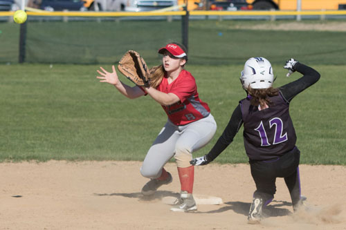 Southold/Greenport second baseman Paige Messana awaits a throw as Hampton Bays' Meghan Harris slides into second base. (Credit: Katharine Schroeder)