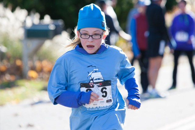 Emma Quarty, 12, of Peconic, finishes her first 5K. (Credit: Katharine Schroeder)