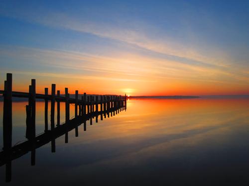 WENDY ZUHOSKI PHOTO   Suffolk Times reader Wendy Zuhoski submitted five shots of a sunrise she captured last week in New Suffolk.