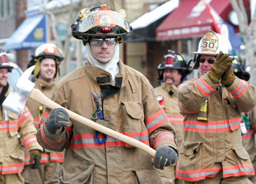 Volunteer firefighters march in a Presidents Day parade hosted by Greenport Fire Department. (Randee Daddona file photo)